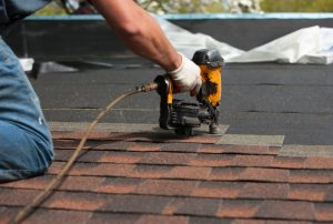 roofers installing new roof on house